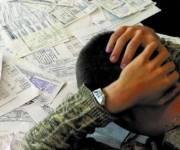 В Кабмине решили, что за одну просрочку коммунальных платежей, монетизацию субсидии наличными отменят